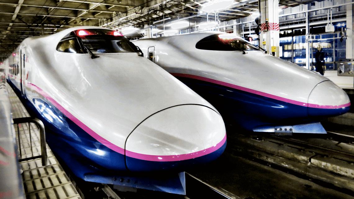 Two shinkansen (bullet trains) await their departure at Tokyo Station, Japan