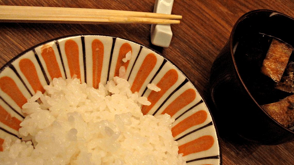 Chopsticks and rice served at Maru, an izakaya in Aoyama, Tokyo, Japan