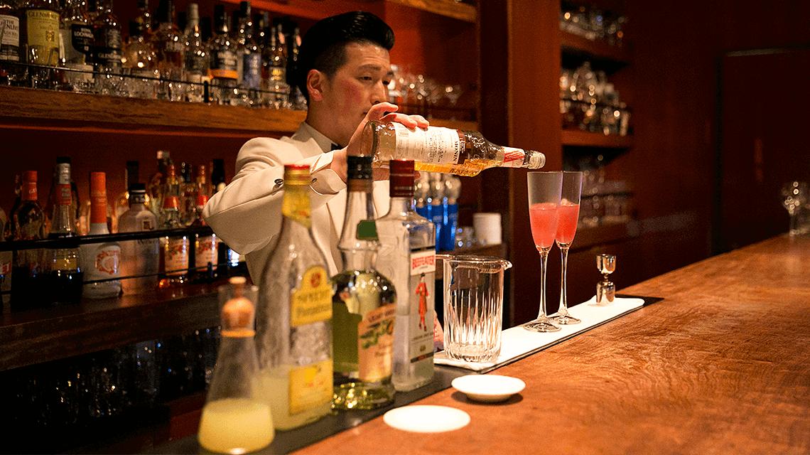A bartender prepares a cocktail at Bar Oscar, Fukuoka, Japan