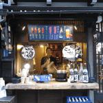 A friendly sake seller in Takayama, Japan