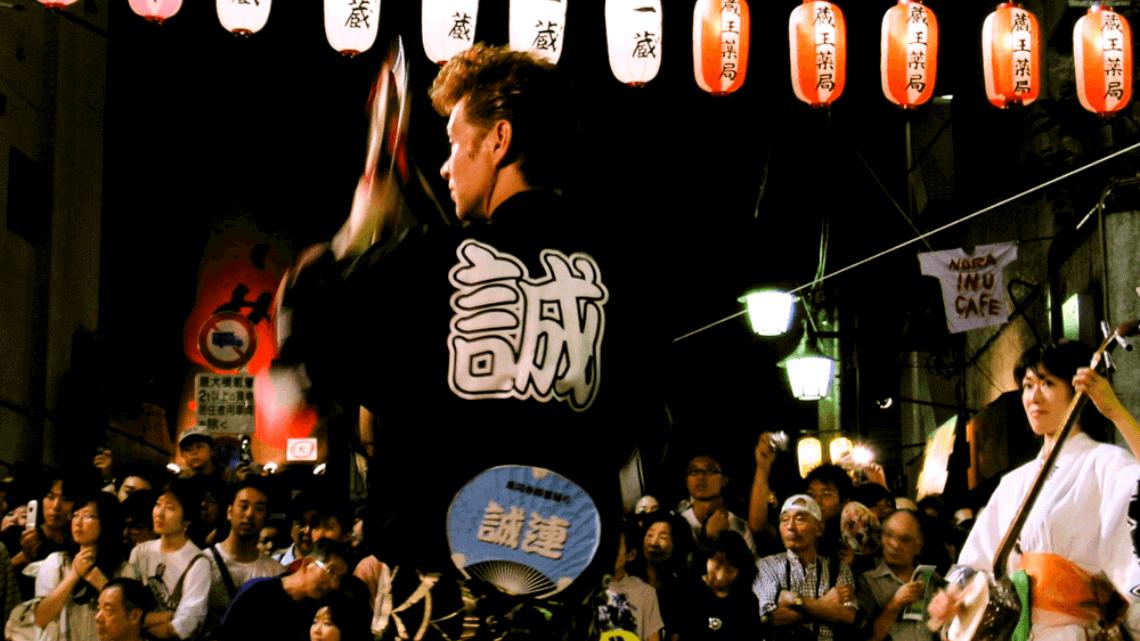A Japanese performer dances with fans at the Awa Odori Festival, Koenji, Tokyo, Japan.