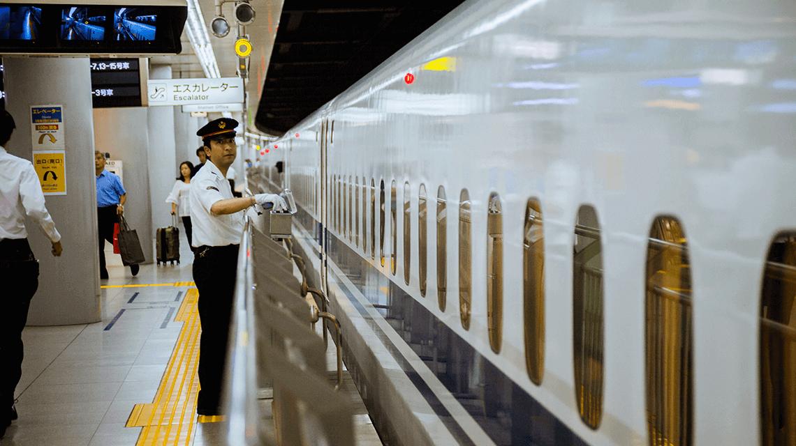 A bullet train (shinkansen) conductor monitoring the train
