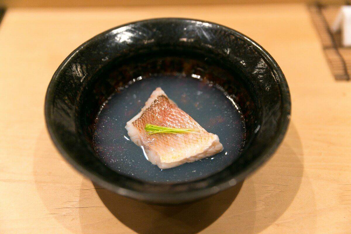 tile fish in clam soup at Harutaka in Tokyo, Japan